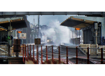 Waves over Dawlish Station